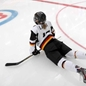 Germany's Andrea Lanzl #15  stretches before facing off against Team Russia during preliminary round action at the 2013 IIHF Ice Hockey Women's World Championship. (Photo by Jana Chytilova/HHOF-IIHF Images)