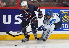 KANATA, CANADA - APRIL 8: USA's Amanda Kessel #28 and Finland's Niina Makinen #14 battle for the puck during semifinal round action at the 2013 IIHF Ice Hockey Women's World Championship. (Photo by Andre Ringuette/HHOF-IIHF Images)