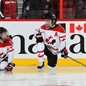 KANATA, CANADA - APRIL 8: Canada's Gillian Apps #10 and Jayna Hefford #16 stretch during warm up prior to semifinal round action against Russia at the 2013 IIHF Ice Hockey Women's World Championship. (Photo by Andre Ringuette/HHOF-IIHF Images)